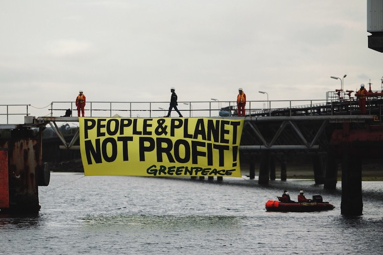 BP and Shell get called 'Climate Criminals' at the Oil and Money conference